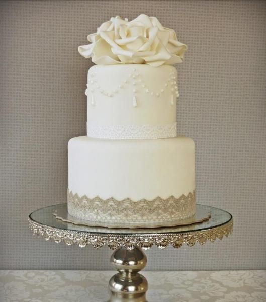 pictures of two tier wedding cakes two tiered wedding cake with beautiful lace detailing 18449