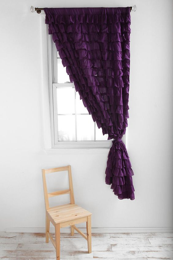 One purple ruffled curtain for $79.00   I would like to attempt to make one, but I wonder if the price is worth it more than the effort it would be to make one...  plus, straight lines are not my forte, so mine would look like it belonged to the little crooked man who lived in a crooked house - or whatever that nursery rhyme was.