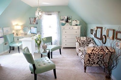 Like use of the slanted wall. Wall color is waterscape from Sherwin Williams.  Desk: Pottery Barn  Settee: Target  Entry Table: Pier One  Tall Dresser: Ikea  Teal Chair:  Marshalls  Mirrored Table: Target.