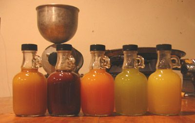 """""""Liqueur is very easy to make. For Christmas this year, I made five different flavors from citrus peel, herbs and spices. From left to right: Tangerine Spice (with nutmeg and cloves), Chocolate Orange, Orange Saffron, Mint Lime, and Meyer Lemon Cardamom."""""""