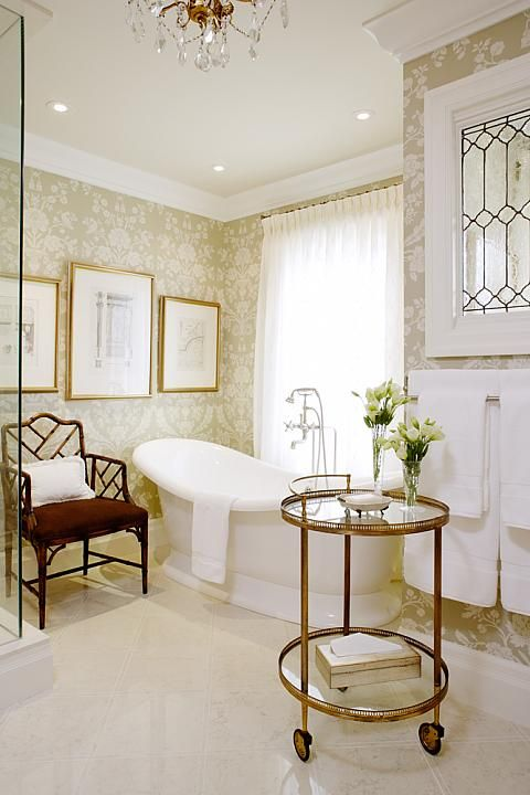 Elegant bathroom with round glass bar cart and freestanding tub. Design by Sarah Richardson. #bathroom #elegant #classic #barcart