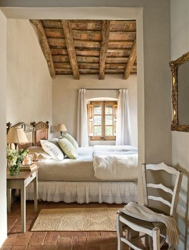 French country decor in a rustic Provence bedroom with wood ceiling and interior shutters. #frenchcountry #frenchfarmhouse #provence