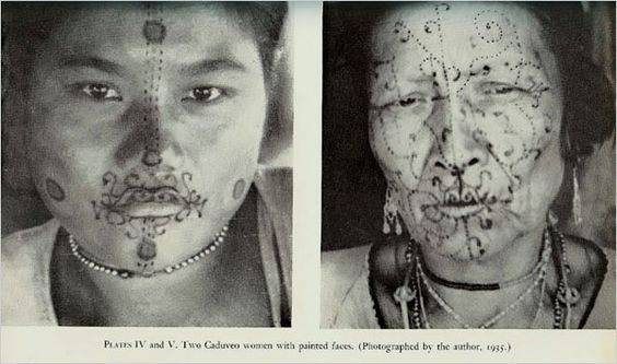 Caduveo women with cosmetic facial painting, Brazil. This facial art is executed with a wooden spatula dipped in the juices of wild fruit and leaves.