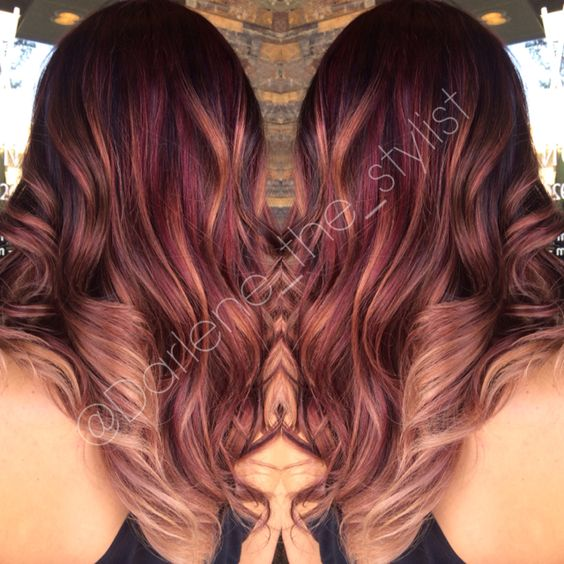 Rich warm balayage with a red base, lowlights, and subtle blonde ombré balayage to