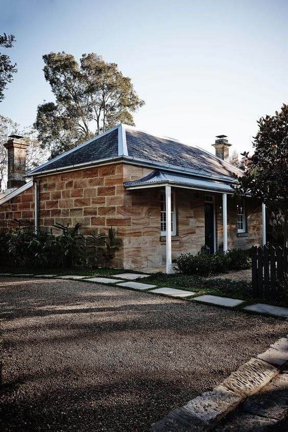 From the street, the original sandstone cottage retains its heritage appeal.
