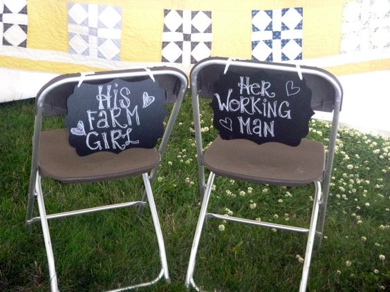signs on back of wedding chairs...his farm girl and her working man