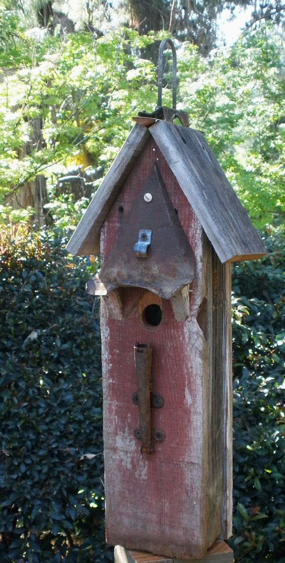 Birdhouse embellished with found objects
