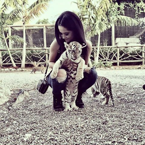 Becky G and a cute baby tiger....