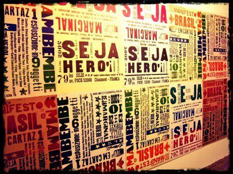 Rico Lins  Be marginal be a hero, 2002  Mixed media (typography and rubber stamp on digital print)  37.8 x 26 in.  Artist's collection     ///    Rico Lins  Seja marginal seja herói, 2002   Técnica mista (tipografia e carimbo sobre impressão digital)  96 x 66 cm   Coleção do artista