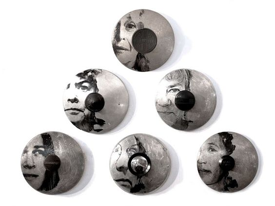 Sally Mankus utilizes old kitchenware, including pot lids and pans, to create mixed-media works such as these portraits