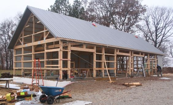 Build a pole barn a quick building guide barn baby barn for Build your own pole barn home
