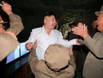North Korea's state-run television KRT broadcasts video and photographs of leader Kim Jong-Un purportedly watching submarine-launched ballistic missile firing.