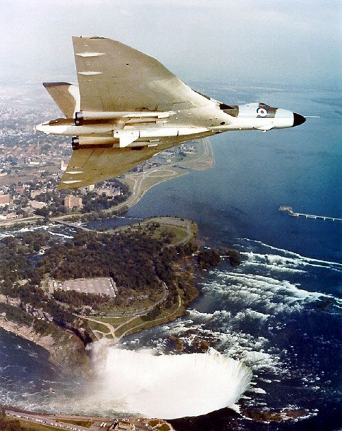 Vulcans in Camera - Avro Vulcan B2 BS XL384. This is a well-used photograph of Avro Vulcan B2 Blue Steel XL384 over the Niagara Falls with a W103A Blue Steel training round. 384 was delivered to No 230 OCU at RAF Finningley in April 1962. It was withdrawn from service in August 1963 and returned to Woodford for reengining with Olympus 301 engines and conversion to B2 Blue Steel. It reentered service with the Scampton Wing in August 1964. In February 1970, 384 was converted back to free…