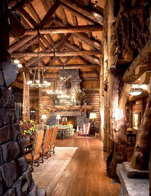 The chandelier log cabin homes and high ceilings on pinterest for Log cabin chandelier