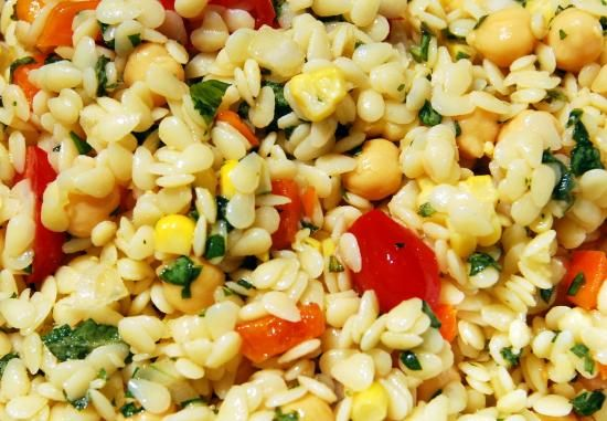 The best summer salad ever...(quote)...good mix of corn, orzo, tomatoes.....and a great sounding dressing
