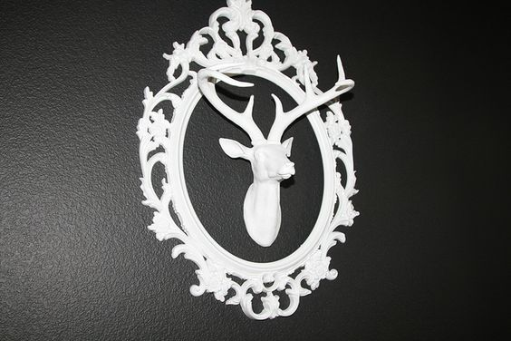 Fauxidermy Tip: mount your small deer head with an all-white frame. Styled by Annie Lane