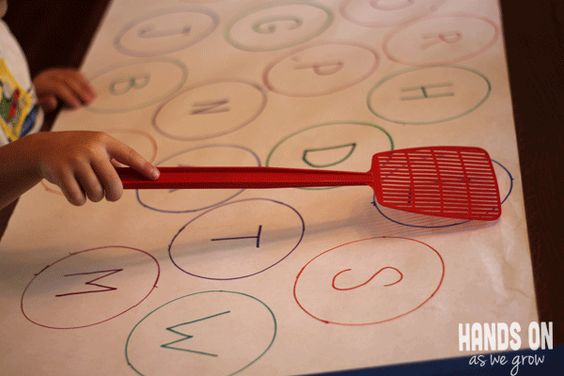 Find the Letter & Swat It!  Since there is no benefit to young children knowing letter names, I'd use letter sounds {phonograms} instead!