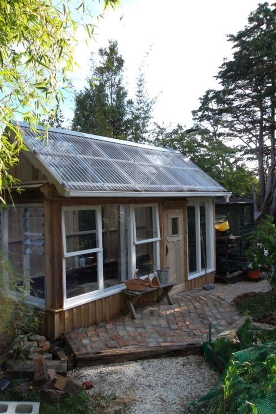 Recycled windows greenhouses and window on pinterest for Reclaimed window greenhouse