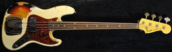 Fender Custom Shop 64 Heavy Relic Jazz Bass Olympic White over Sunburst (sorry not vintage, but I like it!)