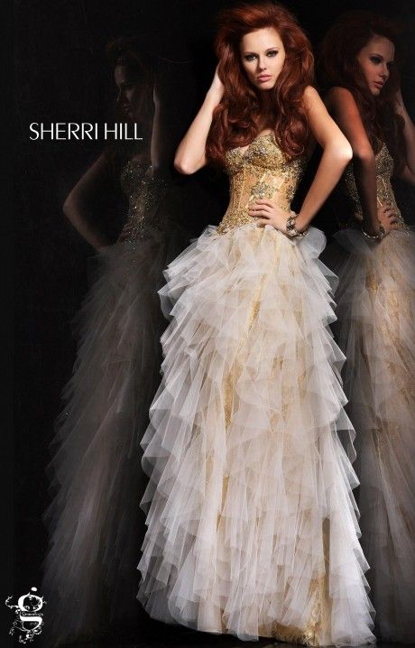 Hello Goddess! You'll love the look you'll portray once you zip up Sherri Hill 11024! This overly stunning style has intricate bead work and lace along the sheer upper bodice. The straight A line skirt is filled with thin ruffles of tulle that lie perfectly along the lace skirt. This prom dress is ideal for any skin tone!
