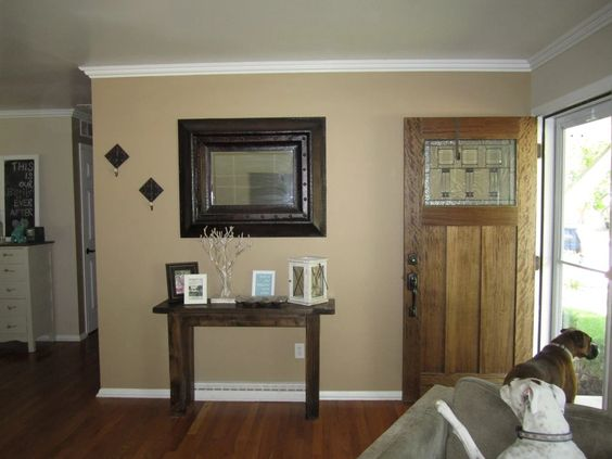 Entry Before in Sherwin Williams Latte  Now it matches the wall behind it and next to it – in Sherwin Williams Kilim Beige