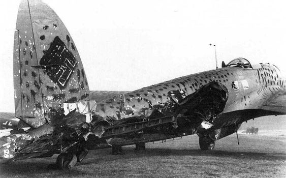 German bomber Heinkel He-111H at the airport with signs of damage from anti-aircraft fire, obtained during a night sortie