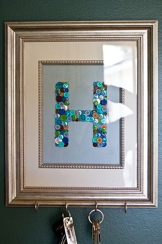 Framed button monogram key holder.  This is also pretty even without the hooks... just as a framed initial.