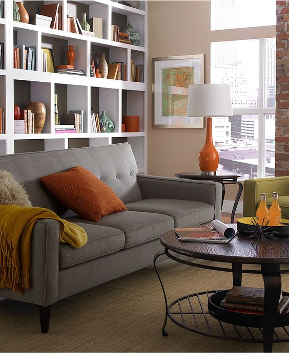 mod tufted sofa + staggered shelving