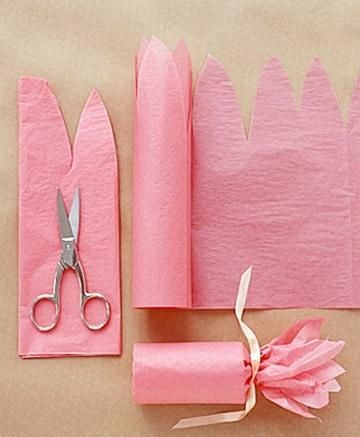 Fill a toilet paper roll with candy, and then wrap pink tissue paper around it in a fun floral shape for a sweet gift.