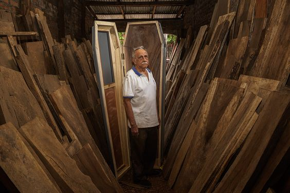 A coffin maker, 80, poses in his workshop in Chichigalpa, Nicaragua on Jan. 7…