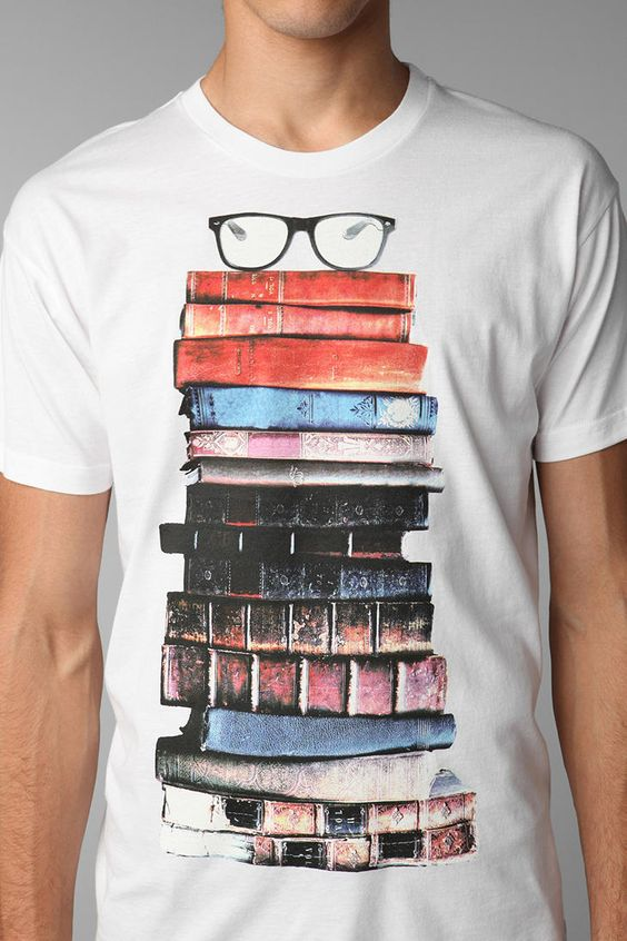 I so need this shirt.>>> Did anyone else realize it's a GUY wearing a book shirt? I need the shirt and the guy lol