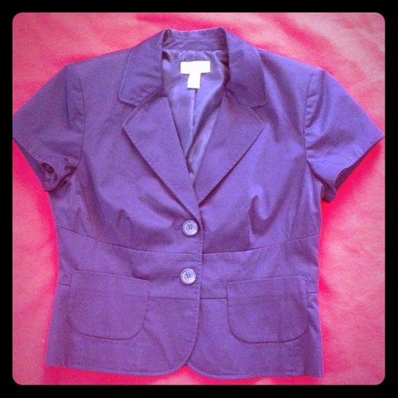 Ann Taylor Loft navy short sleeve blazer | Size 10 Look sharp and commanding in this summer suit separate. The blazer pairs well with a navy patterned skirt, or with crisp gray pants. Blazer is a washable cotton/spandex blend. Two buttons on the back add extra detail. Know before you buy: the price tag went through fabric in the left sleeve (see photo). Ann Taylor Loft Jackets & Coats Blazers