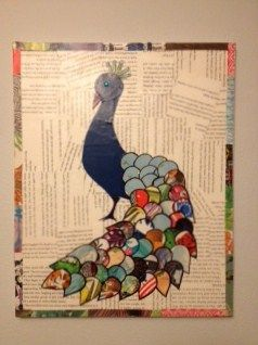 I just can't get enough of projects using recycled books! here is my latest: a proud peacock.
