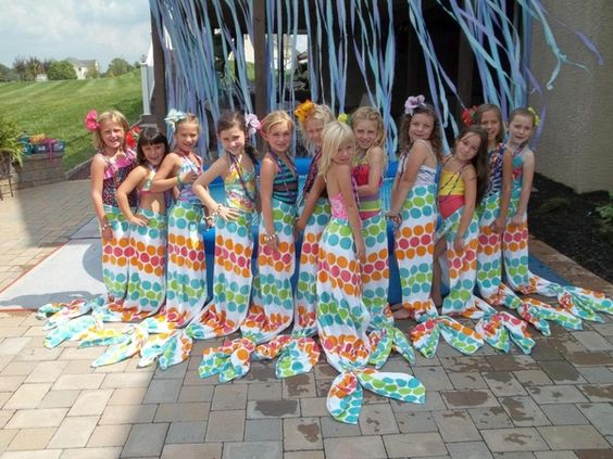 Great idea from FamilyFun reader Kim Fuglestad of Wrightstown, PA: Last year, my 8-year-old had a mermaid-themed party. For favors, Nicolette wanted to make a mermaid tail for each guest. I wanted the tails to be both practical and washable, so I came up with the idea of making them from beach towels. I added Velcro tabs to one end of the towel so that it could be easily secured around the waist. To create the flukes, I wrapped two ponytail holders around the bottom.: Velcro Tab, Towel Tail, Towel Mermaid, Beach Towel, Mermaid Towel, Party Idea, Mermaid Tail
