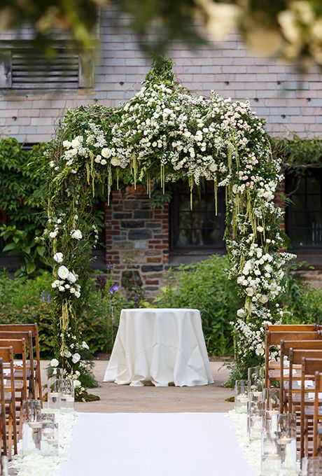 Brides.com: 73 Amazing Ceremony Structures A rustic wooden chuppah, with a scalloped lace canopy and gold and crystal chandelier, overlooks the hills of Tuscany.Photo: Jose Villa