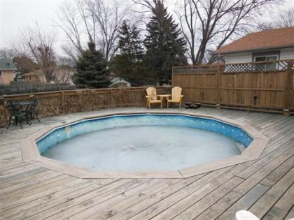 We wrap around deck and above ground swimming pools on for Uses for old swimming pools