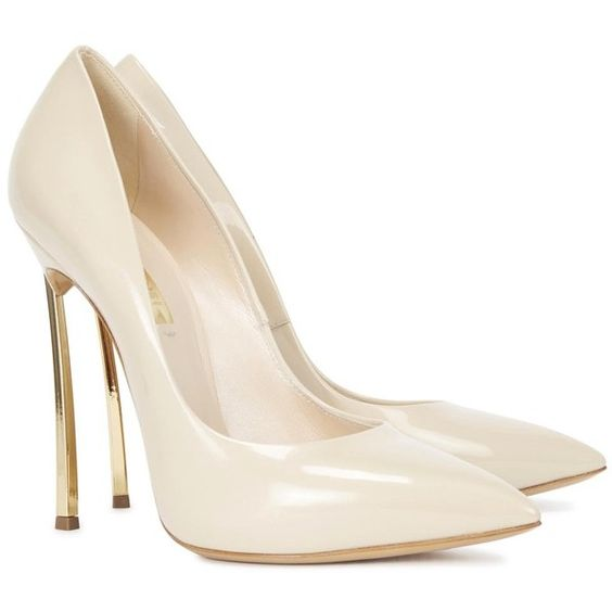 Casadei cream patent leather pumps. Gold tone heel measures approximately 5 inches/ 125mm. Pointed toe. Slip on. This style runs true to size. Narrow across th…