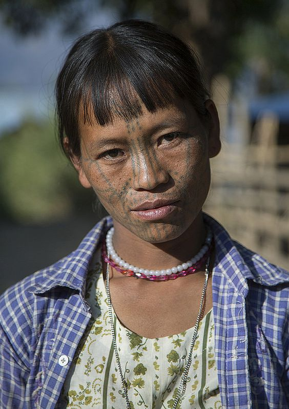 Tribal Chin Woman From Muun Tribe With Tattoo On The Face, Mindat, Burma. Her tattoos are represents the tiger.