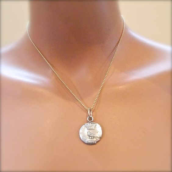 Iconic British Silver Raven Bird and Crown Necklace by YourDailyJewels,