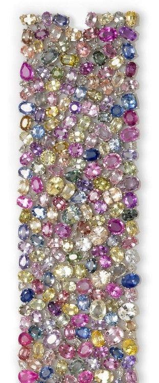 Multi color sapphire and diamond bracelet composed of various shaped multi-color stones, including rose-cut diamonds. Estimated total sapphire weight 182.00 carats and total diamond weight 2.00 carats (via Crystal Compulsion ❤)