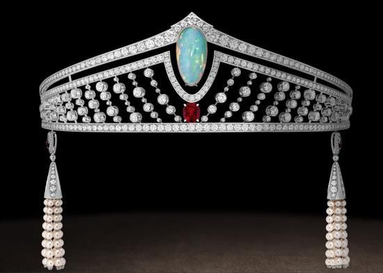Tiara in platinum, diamonds, set with a twenty-one carat cabochon-cut white opal and a three carat Burmese pigeon's blood ruby. Pendants in platinum, diamonds, cultured pearls and rubies. The pendants can be attached to the back or front of the tiara or detached and worn as earrings. Chaumet, Paris.