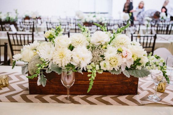 Not sure if I like or not...debating going all greens/whites for rehearsal vs lots of fun spring colors, but kind of like low long centerpieces for the long tables  #centerpiece #dahlia Photography by kaylaadams.net Floral Design by maranathaflowers.com/  Read more - http://www.stylemepretty.com/2013/08/01/riverside-wedding-from-kayla-adams/