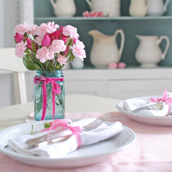 Simple touches of pink and white create festive Valentine's Day decor in the dining room.