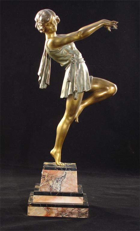 arge Art Deco patinated spelter figure on stepped marble base unsigned:
