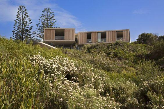 Materiais naturais na casa aberta à praia - Casa Vogue | Casas