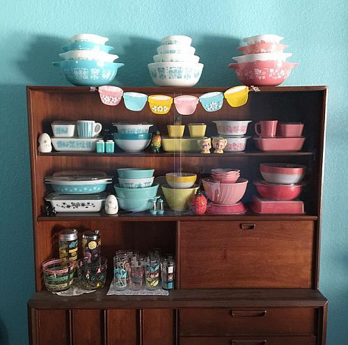 Vintage Pyrex collection displayed in midcentury hutch