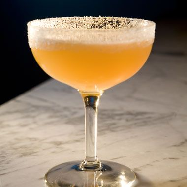 Sidecar- Cognac, Triple sec and Lemon Juice. http://www.epicurious.com/articlesguides/drinking/cocktails/summercocktailssidecar/recipes/drink/photo/Sidecar-350783