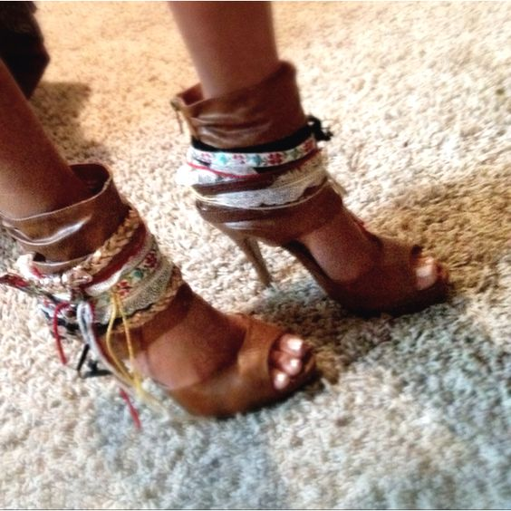 DIY Boho Heels!   Just hot glued ribbon, feathers, belts, yarn, and string made of t-shirts onto the cuffs of these heels.