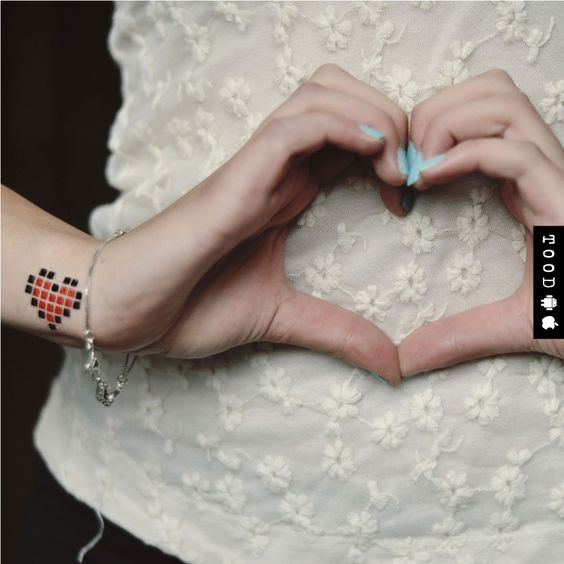 8-bit style digital heart temporary tattoo sticker on wrist