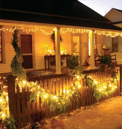 Light Up the Night  Create a monochromatic display using simple white lights wherever you can place them. String lights along the fence (woven into fresh garland) and down the eaves. Dress a welcoming table with white pillar candles in hurricane vases.    Tip: When hanging garland along a fence, use string instead of wire, which can scratch the paint.
